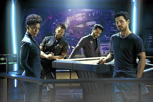 Dominique Tipper as Naomi Nagata, Wes Chatham as Amos Burton, Cas Anvar as Alex Kamal and Steven Strait as Earther James Holden in 'The Expanse', now streaming on Netflix.
