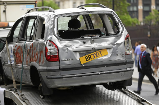 Car crash: Pro-EU campaign group Open Britain drive a broken car around Parliament Square on a low loader, as the government releases their Brexit White Paper, in London. Picture: REUTERS