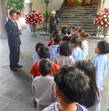 Photo: Finally we are allowed inside as part of this group of 5-year-olds.  Our guide (left, in suit) addresses the kids.