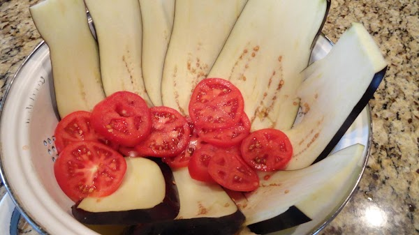 Slice zucchini and eggplant lengthwise in 1/4-inch slices and tomatoes in 1/2-inch rounds. Line...