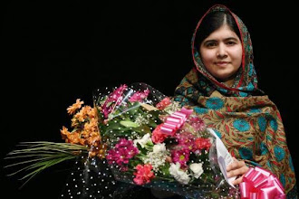 """Photo: Pakistani rights activist Malala Yousafzai poses for a photograph after addressing the media in Birmingham, central England on October 10, 2014. The Nobel Peace Prize went Friday to 17-year-old Pakistani Malala Yousafzai and India's Kailash Satyarthi for their work promoting children's rights. Seventeen-year-old Nobel Peace Prize winner Malala Yousafzai said she was """"honoured"""" to be the first Pakistani and the youngest person to be given the award and dedicated the award to the """"voiceless"""". """"This award is for all those children who are voiceless, whose voices need to be heard,"""" she said. AFP PHOTO / OLI SCARFF        (Photo credit should read OLI SCARFF/AFP/Getty Images)"""