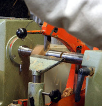 Photo: The copy lathe In action with one blade -- making a small cedar ball for a deck. The order is for 1000.