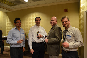 Photo: Alfredo Romero and Mark Burkey (co-editor of The Review of Regional Studies) talk with Daniel Mackay and Greg Kerr (U Richmond) at the reception