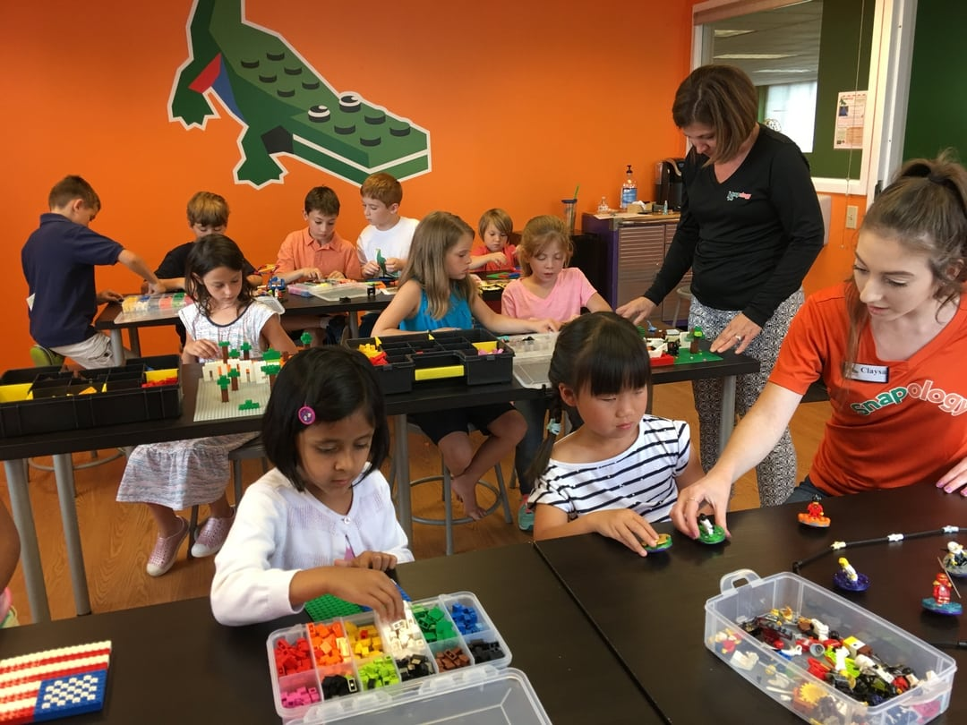 classroom of young children playing with LEGO
