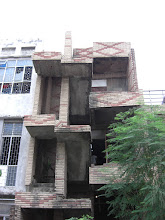 Photo: a building in Malviya Nagar. My questions: is it under construction? has construction stopped till more funds come in? Something else? There are half, unfinished, and buildings with rebar sticking out of them all over Delhi