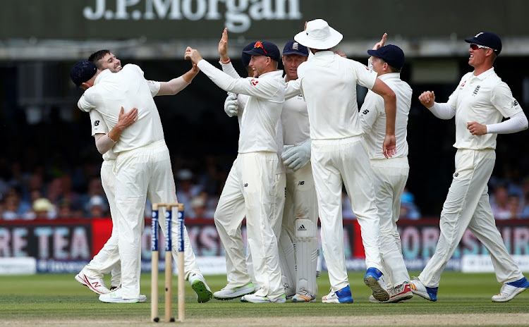 England's Mark Wood celebrates with teammates after taking the wicket of South Africa's JP Duminy.   Picture: REUTERS