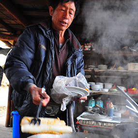 Chinese food seller by Tanawat Pontchour - People Portraits of Men