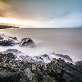 Orange clouds on blue sky by Danny Charge - Landscapes Waterscapes ( waves, blue sky, coastline, oranges, long exposure, water, sea, rocky, orange, coast, seascape, rocks, blue, waterscape, belfast, coastal )