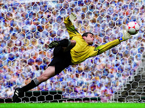 Photo: 27 Apr 2004 --- Soccer Goalie Trying to Block Goal --- Image by © Royalty-Free/Corbis