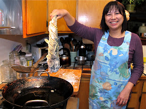 Photo: Sandy ready to slide fish into a wokful of hot oil