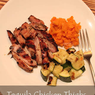 Tequila Rosemary Chicken Thighs with Parmesan Zucchini and Baked Sweet Potato.