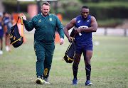 The Springboks assistant coach Matt Proudfoot arrives at South Africa training session along with front row forward Tendai