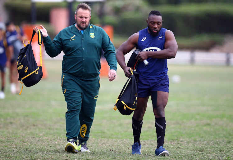 "The Springboks assistant coach Matt Proudfoot arrives at South Africa training session along with front row forward Tendai ""Beast"" Mtawarira at Jonsson King's Parkin Durban, South Africa on August 14 2018 ."