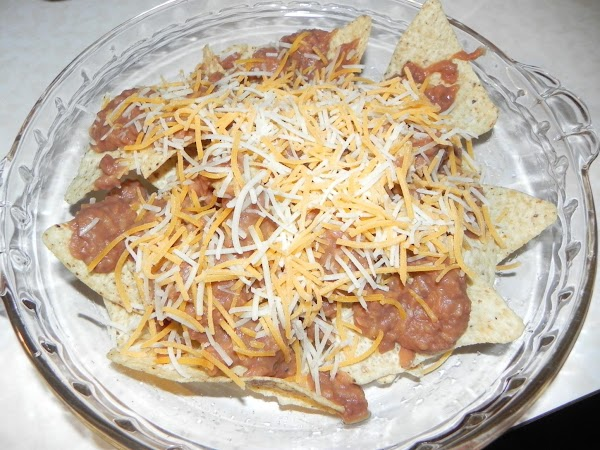 Put this in a dish that can go into the oven. Layer the tortilla...
