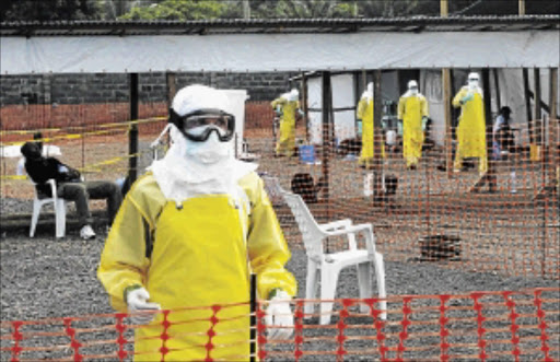 PROTECTIVE GEAR: Medicins Sans Frontieres health workers prepare at  an isolation camp in Liberia  PHOTO: REUTERS