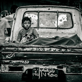 The little boy by Hany Todros - People Street & Candids ( car, black and white, truck, street, poor, little, photo, photography, egypt, city, life, sigma, cairo, nikon, boy, hanytodros )