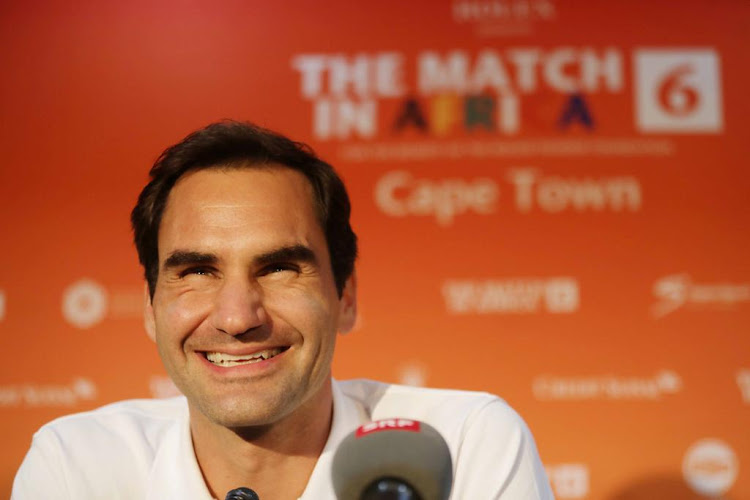 Roger Federer smiles during his trip in South Africa.