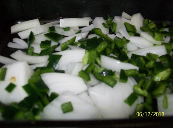 Cut the pepper into small pieces; add ½ on the top of the onions.
