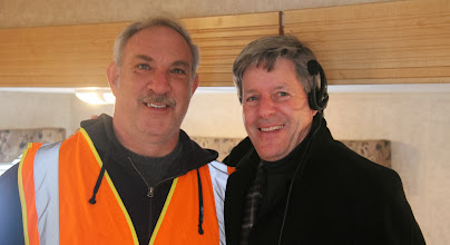 Photo: George Geiss, Facility Supervisor, and colleague take quick break in the staff trailer.