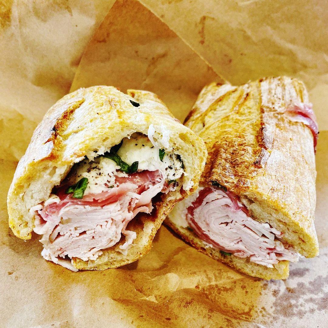 Goose sandwich from Goose the Market. Ingredients include prosciutto di parma, fresh mozzarella, basil, pepper & olive oil
