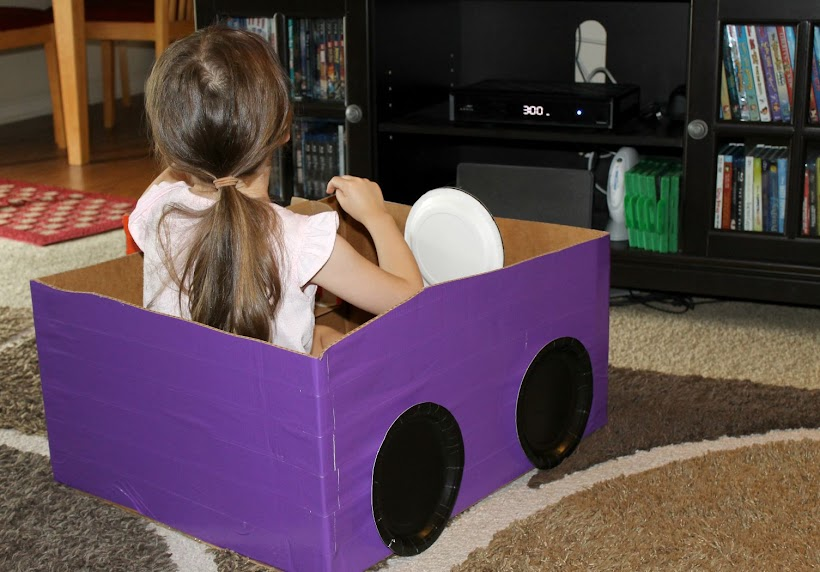 This easy DIY cardboard box car is great fun for your kids! Let their imaginations run wild as to where they'll travel or use it for a drive in movie theater in your living room or backyard