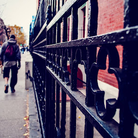 One pant leg up by a fancy fence by Heather Hoppe - City,  Street & Park  Street Scenes