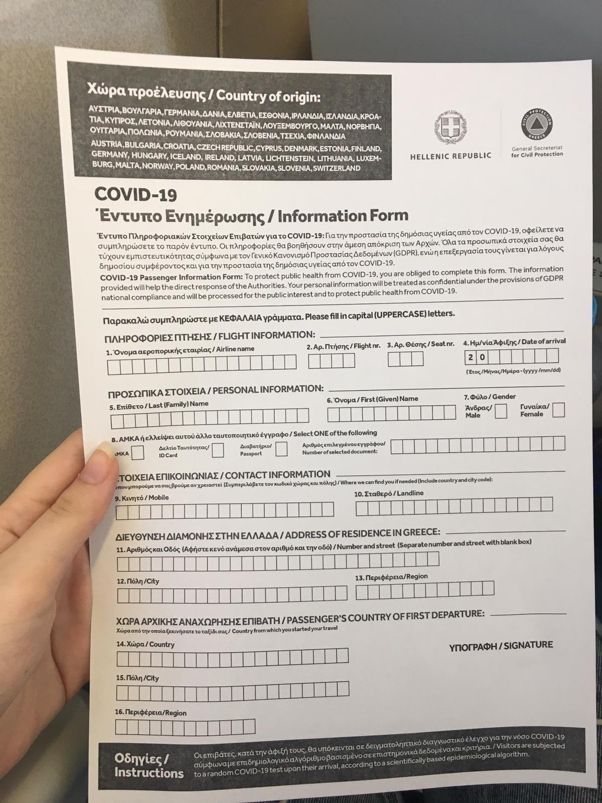A COVID-19 information form handed out on airplanes arriving in Greece. All passengers are required to fill out locator forms and are subject to 24-hour self-isolation upon arrival.