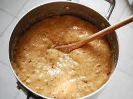 in a large pan with candy thermometer attached to the pan on medium heat...