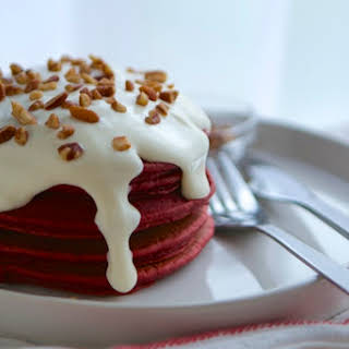 Red Velvet Pancakes with Warm Cream Cheese Glaze.