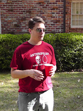 Photo: Dr. Geoff Thomas, FSU faculty.  Not his first pig roast!.