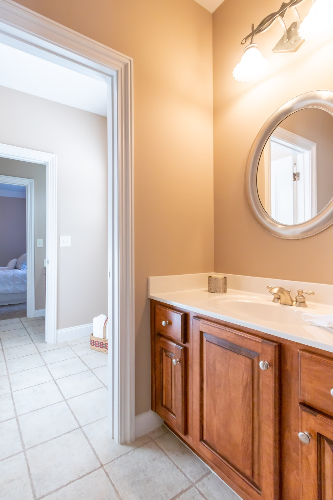 When staging a bathroom, declutter countertops. Only stage with a decorative item or two.