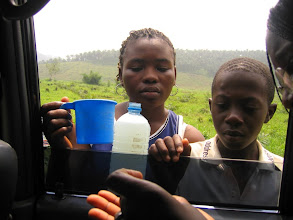 Photo: Selling palm wine on the road