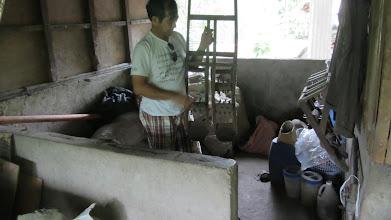Photo: A farmer examines the double weeder.