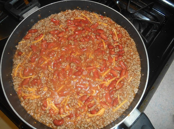 mix the meat,beans,the enchilada sauce,shred cheese , the tomatoe sauce together. Add the hot...