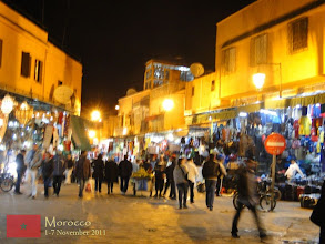 Photo: the busy souks at the side of Djemaa El-Fna in Marrakech