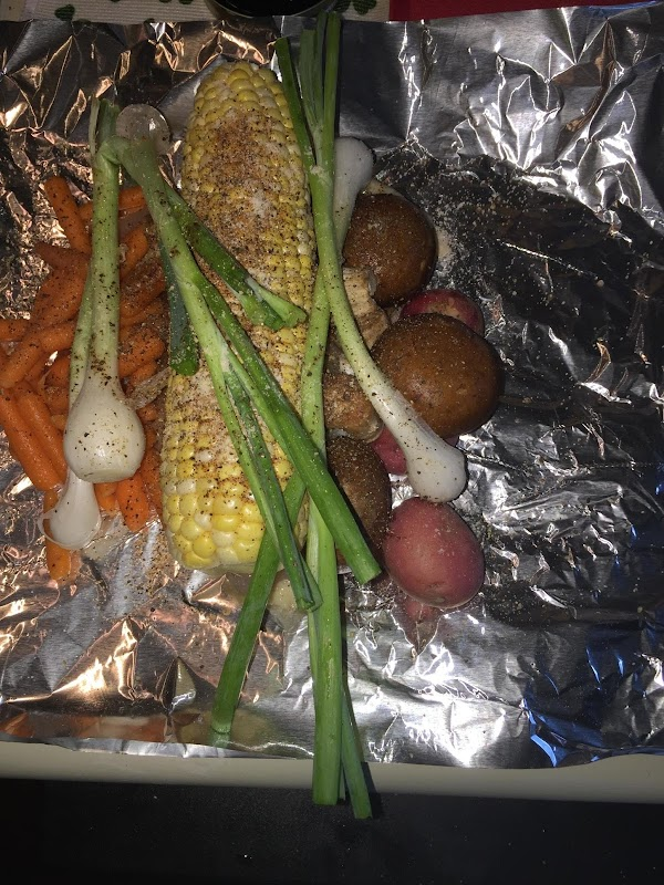 In the middle of the foil lay a chicken breast, sprinkle with spice blend,...