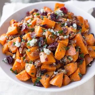 Warm Roasted Sweet Potato Salad with Apple-Smoked Bacon, Blue Cheese, Dried Cranberries and Pecans in Warm Bacon-Herb Vinaigrette