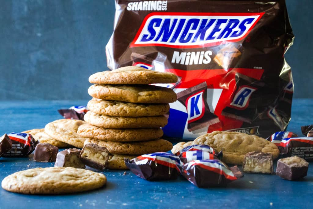 stacked cookies and bag of snickers minis
