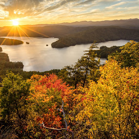 Fall Color Over Lake Jocassee by Tom Moors - Landscapes Waterscapes ( mountains, jumping off rock, lake jocassee, sunset, foliage, fall, trees, lake, south carolina )