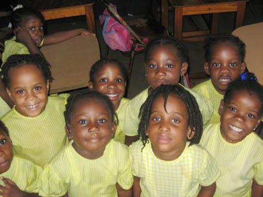 Preschoolers in Antigua greet a volunteer worker from Hope Floats.