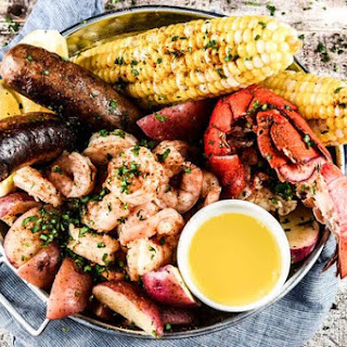 Backyard Seafood Boil with lobster, shrimp, and spicy sausage