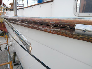 Photo: Removing Pilgrim's stainless rub rails revealed a nasty, intermittent gap between the to pieces of teak that comprise the M382 cap rail.