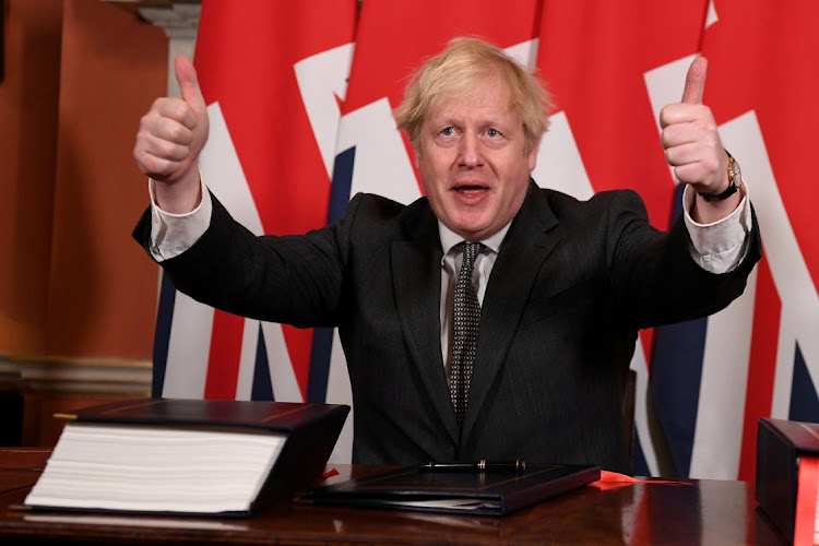 Britain's Prime Minister Boris Johnson gives a thumbs up after signing the Brexit trade deal with the EU in London, Britain, December 30 2020. Picture: REUTERS/LEON NEAL