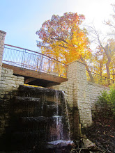 Photo: Waterfall under a bridge and golden leaves at Hills and Dales Park in Dayton, Ohio.