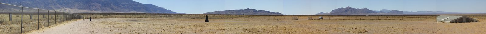 Photo: Panoramic view of the Trinity Site looking Southwest from the fence with the photographic images to the obelisk to the gate and finally to the bunker.