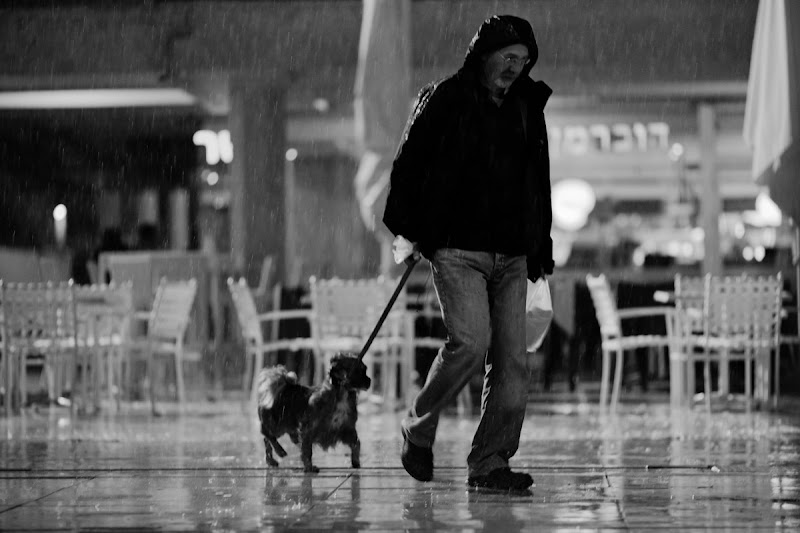 """Photo: joyless couple under rain or i have another one let's go home, man it wasspontaneousand short but such powerful and vernal !  Photography book """"the streets are calling you"""" http://www.blurb.com/bookstore/detail/3540967  #happynewyear"""