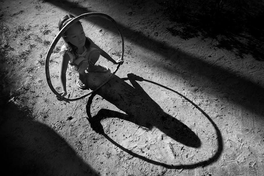 Shadows by Samuel De Leon - Babies & Children Children Candids ( child, hula, shadow, play, hula hoop, children, hoop, game, people )