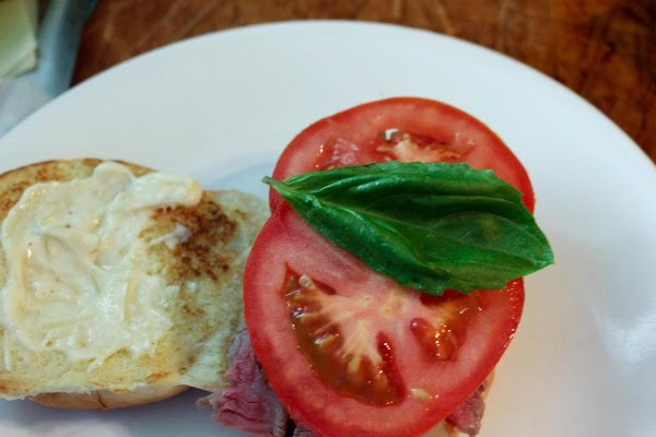 Basil and tomatoes placed on top.