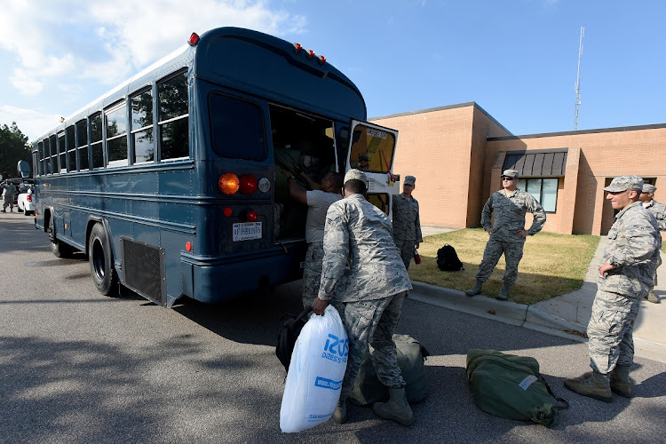 US airmen from the South Carolina Air National Guard and 169th Fighter Wing prepare to deploy to support rescue efforts in advance of Hurricane Florence at McEntire Joint National Guard Base in South Carolina, US, on September 10, 2018. Picture: REUTERS