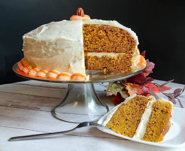 Pumpkin Gingerbread Layer Cake With A Slice Cut.
